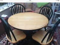Light wood table with 4 chairs for sale