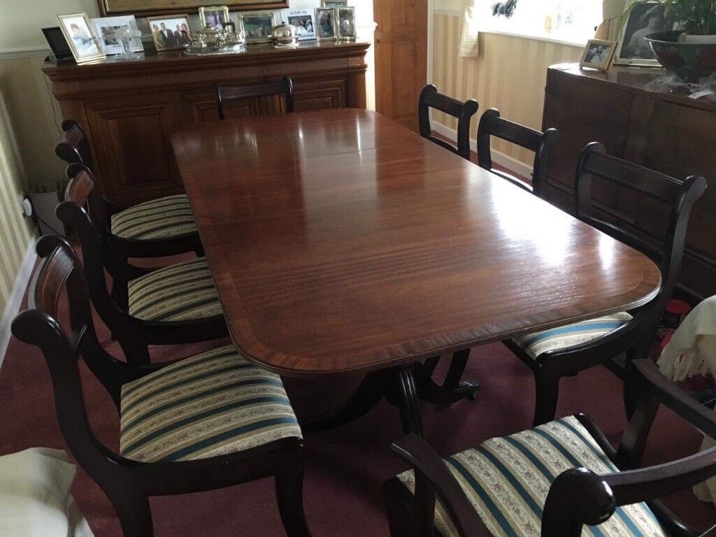 Dinning table with 8 chairs including 2 carvers all in great condition