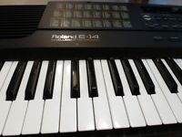 As new ROLAND E-14 keyboard ..E, FOR INTELLIGENT..