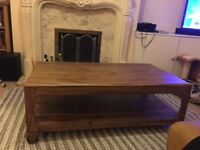 Solid rose wood coffee table in excellent condition
