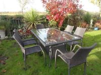 RATTAN GARDEN SET -- LARGE -- TABLE AND 6 CHAIRS --