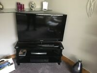 "Samsung 40"" flat screen television and glass stand"