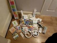 Nintendo Wii +14 Games + Wii fit board and accessories