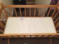 Rocking crib and new mattress