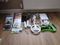 Wii game console, numchucks, steering wheels, controlsbattery charger, plus will fit and games