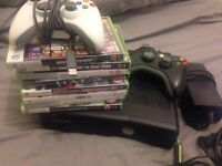 Xbox 360 with 2 conrollers and games including gta5, and fifa 16