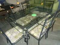 Lovely glass and wrought iron dinning table & 6 chairs