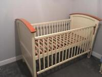 Cot bed with mobile and changing table