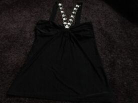 Black top size 12 Stretchy material two chain straps with stones into material back straps