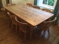 Large farmhouse wooden table and 8 farmhouse dining chairs (one with arms)