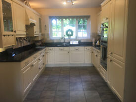 Cream kitchen, granite work tops, Neff oven, halogen hobb, integrated fridge freezer, extractor fan