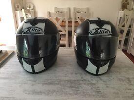 2 x-lite crash helmets. 1 large, 1 medium. Hardly used. Model X 601