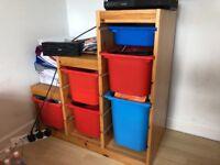 IKEA storage unit including boxes
