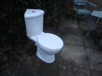 White close coupled corner toilet