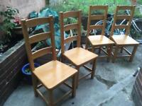 4 solid wood pine dining chairs