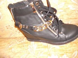 ladies black boots size 5 brand new has zips both sides and back heel chain across front