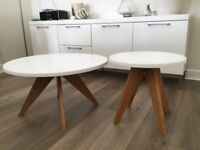 As new two M+S coffee tables, large h 40cm dia 76 cm small h45cm dia 48cm white tops wooden legs