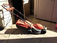 Flymo Lawn Mower (handles fold down for easy storage)