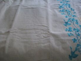 Stone coloured lined curtains, teal embroidered detail. Ring top (127/8)