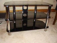 Corner TV Stand. Used. Black 8mm Glass & Chrome Legs. Width. 80cm.Depth.45cm. Height. 52cm