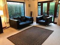Modern Black Leather 2 Seater Sofa And Armchair Chrome Feet Less Than 4 Years Old