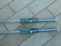 2 Dunelm telescopic curtain poles in brushed steel. BNWT