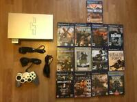 PlayStation 2 console and lots of war games. Ps2