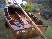 Clinker built family 14 foot sailing dinghy.