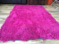 Bright pink fluffy shaggy rug