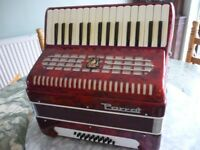 beautiful quality red pearscent parrot accordian with original case & straps,excellent condition....