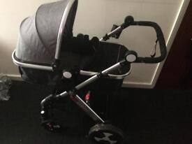 Grey and black buggy with bag