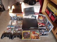PS3 160GB + 2 controllers + 13 games + headset