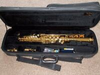 Soprano Saxophone. Good condition, with rucksack style case & straight and curved crooks.