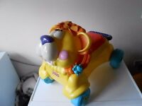 Fisher Price sit,ride lion with sounds and music!