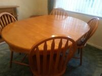 Table and 4 chairs and TV Cabinet in excellent condition.