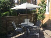 Patio table & 4 chairs with removable parasol