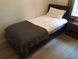 Single bed, dark brown faux leather