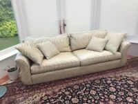 Large cream patterned sofa