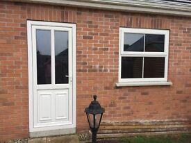 White UPVC garage door and window