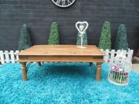 INDIAN WOOD LARGE COFFEE TABLE VERY SOLID AND STURDY AND IT'S IN EXCELLENT CONDITION