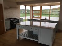 Framed, painted kitchen with granite worktops includes two islands
