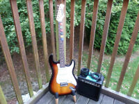 Zennox Stratocaster Electric Guitar & G15 Amplifier Lead Plectrums Leather Strap