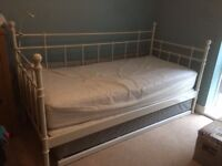 Single Bed and trundle frame with two mattresses.
