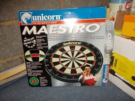 used once still in box dartboard