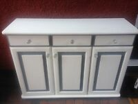 3 doors & 3 draws cabinet white and grey with glass handles.