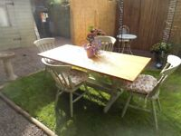 Cottage style solid table and chairs with heart cut-outs and cushions. ( Please make an offer)