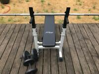 Weights bench with bars and mixed weights