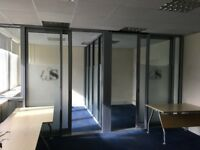 Grey Aluminium and thick glass glazed office partitions with sliding doors