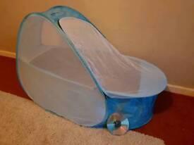 Samsonite pop-up travel cot/bassinet, light blue
