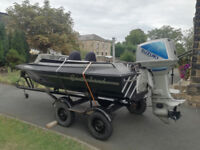 Suzuki outboard DT75 and boat